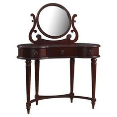 """Wood vanity with three drawers and a center mirror.   Product: Vanity and mirrorConstruction Material: WoodColor: BrownFeatures: Multiple drawers provide storage space for a variety of itemsDimensions: 50"""" H x 40"""" W x 18"""" D (overall)"""