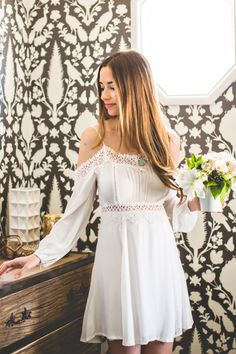 The perfect sundress is here to stay! We love this unique and feminine take on the classic white sundress! From the cold shoulder cut and pretty crochet details, this flirty mini dress is a fuss-free