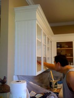 love the beadboard on the cabinet end and beefed up trim