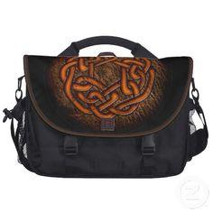 Orange celtic knot on leather laptop bag