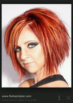 Red hair, highlights, a line haircut