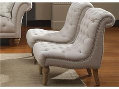 The stylish, tufted accent chair will add class to any room. The off-white linen-look fabric cover has generous button tufting and silver nailhead trim.