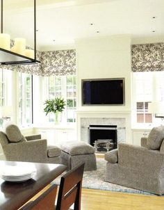 another idea to make fireplace focal point: fabric shades in a bold print on windows?