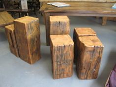 Outdoor end tables made from old rail road ties or barn beams