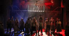The colours in this scene represent the colours of the french flag. Blue, white and red. This is used because the play, Les Miserables, is set in France during a revolution.