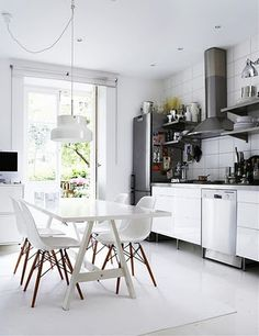 This kitchen with eames chairs is just gorgeous!