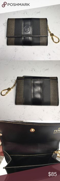 """NWOT 🎀FENDI Vintage Wallet Purse with Key Chain🎀 NWOT Never worn Authentic FENDI Vintage Wallet Coin Purse Key Chain This stylish vintage purse is crafted of classic Fendi  canvas leather. The purse opens with a snap to a brown leather interior. The purse features a chain with a clasp to use as a key ring or to attach to your Fendi handbag. This is a marvelous coin purse for everyday convenience, from Fendi! Size: Length: 6"""", Height: 4"""".  0154320765 Fendi Bags Wallets"""