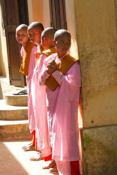 Young monks in pink