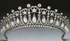 For Queen Mary entitled the Cambridge Lovers Knot tiara by E. Wolff and Co. for Garrard, c. 1913