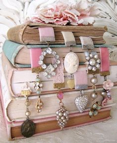 book marks from old earrings and brooches- velvet ribbon. Another book centerpiece idea.