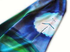 Dandelion silk scarf. Blue silk scarf with dandelion theme. Dandelions in blues and greens. This one features spring like colour scheme, green for grass and blue for lake. Dandelions contrast quite against blue, it makes them stand out a lot. Hand painted by SilkAgathe.
