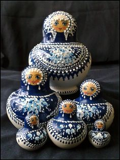 Five piece blue and white Matryoshka doll set.  I've noticed the blue and white dolls that are painted this style are often short and round.