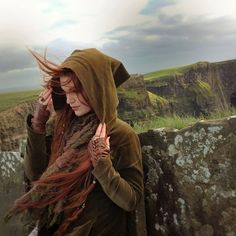 Visual Prompt #Fantasy (Alba felt the wind blow by. She secured her hood to cover her face and her trademark red hair. It would be soon, she thought. She would return soon and take back her kingdom.)