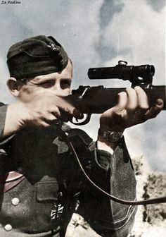 German soldier with k98 fitted with Soviet PU sniper scope