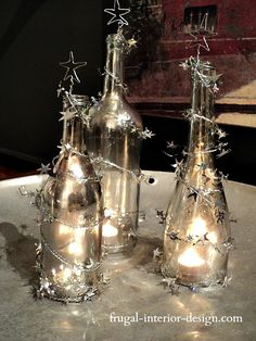 Diy mercury glass wine bottles, use krylon looking glass spray, add wire star, and garland, add tea light