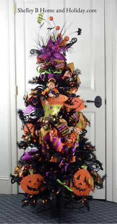 Decorate a tree for Halloween with our Halloween tree kit.  Shop our decorated…
