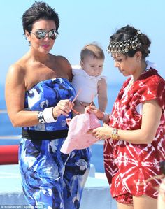 Grandmother's footsteps: An extremely dressed up Kris Jenner took charge of the 10-month-old Penelope Disick while Kourtney Kardashian slipped on a red and white tie dye dress