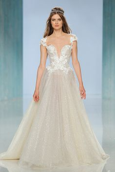 """Princess wedding gown """"Liliya"""" with sexy neckline and gossamer skirt // In our second feature on our favourite designers at Barcelona Bridal Fashion Week 2017 which we covered as an Official Media partner, we fix our gazes on Galia Lahav's bohemian Gala No. IV line and dramatic Victorian Affinity 2018 collection. The standout pieces for us on the catwalk? """"Thelma"""", a homage to Queen Victoria's wedding gown with sheer drape silk tulle sleeves and """"Liliya"""", a fairytale ball gown made of real…"""