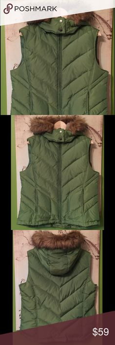 "IZOD Perform X Hooded Puffer Vest This puffer vest is perfect for those days when you need an extra layer but not a full coat. Fashioned with a zip-off hood, this quilted design has two zipper pockets at hip and three interior pockets. 🍃Stand collar; removable zip-off hood 🍃Zipper closure at front 🍃Zipper pockets at hip 🍃Lightweight 🍃Hits at hip; approx. 24"" long 🍃Shell & lining: 66% nylon; 45% polyester 🍃Machine washable Izod Jackets & Coats Vests"