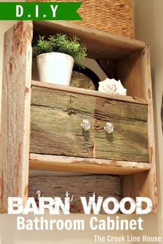 DIY Barnwood Bathroom Cabinet made by taking an old cabinet apart and rebuilding it using barnwood instead! - loving this!