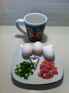 Egg in a cup!! This recipe has it all, bacon, cheese, egg, onions and only 2 weight watcher points. I love this dish so much I have it almost everyday for lunch. Another great adaption from the Hungry Girl cookbooks.