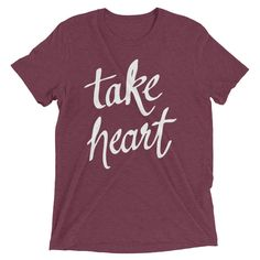 "Take Heart T-Shirt - Inspirational Apparel from 7th & Palm   Inspired by learning to persevere through difficult personal experiences, these illustrated prints are a strong visual reminder of hope and faith. This white ""take heart"" print uses a handwritten script by artist Andrea Smith, reminding us to rest in the peace only God can provide. Buy two and share with a friend who needs encouragement during a difficult time."