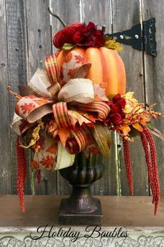 Sharing a fall pumpkin centerpiece created by Holiday Baubles. It's for sale in her Etsy shop. Shop Trendy Tree for fall ribbons, mesh, florals and more! Harvest Decorations, Thanksgiving Decorations, Holiday Decorations, September Decorations, Thanksgiving Diy, Fall Wreaths, Christmas Wreaths, Halloween Wreaths, Halloween Town