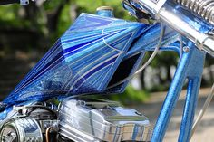 Evo Sporster hardtail custom digger with skinny extended springer, prism tank and blue monotone metal flake paint job | The Head Company | tank detail
