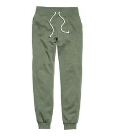 Khaki green. Soft sweatpants with an elasticized drawstring waistband, side pockets, and ribbed hems. Brushed inside.
