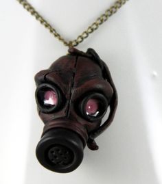 Love & want this! Really neat handmade gas mask necklace from NeverlandJewelry/Etsy $28.00