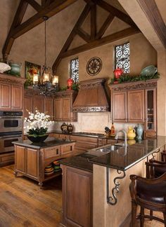 Gorgeous Tuscan kitchen. Love the beams, the wall treatment and look at the windows!