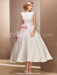 This could be a very pretty wedding dress; with a red belt for me please.