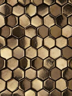 Metallic Ceramic Alexander Bronze A bronze example of our Alexander tile, which is available in a variety of ceramic finishes, this clever little tile is supplied with a variety of varying angled faces, which when laid in formations can create different shades on a surface. We can use Alexander to illustrate imagery, text or even just create abstract textures as shown.