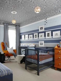 BOYS ROOM The genius of Sarah Richardson - incorporating carpet colour stripe in feature wall to link floor, wallpapering the ceiling, pom pom trim drapes, double light fittings...