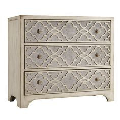 """Aurelia Chest - Shades of Gray on Joss & Main. 3 drawer chest showcases quatrefoil overlay and mirrored panels for glamorous style. Made of hardwood solids, oak and cedar veneers, and mirrored glass. Silver finish. 33""""H x 36""""W x 18""""D. $898.00"""
