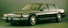 1986 Cadillac Seville. Mine was white with a blue, cloth interior.