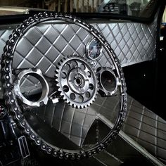 sheet metal interior using a diamond pattern embossed bead roller in the sheet panels and a custom made steering wheel out of chain, timing gear, and connecting rods.