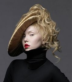 A long blonde straight coloured quirky avant garde sculptured hairstyle by Steven Carey