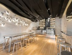 beautiful! I love the backlit chrome with the soft warm floors and dark ceiling! Chrome, white, black and natural wood :)  10 International Coffee Shops