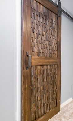 Want a different take on a sliding barn door? This texture is amazing! | DIY barn door | wood shim project