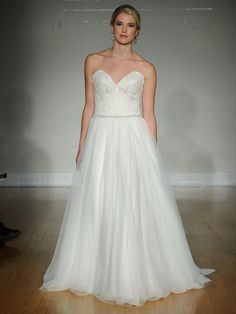 Allure fall 2016 wedding gown with low sweetheart neckline, lace bodice and beaded belt with flowing tulle ball gown skirt | https://www.theknot.com/content/allure-wedding-dresses-bridal-fashion-week-fall-2016