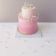 Two Tier Birthday Cake With Rustic Finish And Pink Ombre Buttercream Fresh Delicate Floral Arrangement