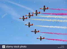Patrulla Aguila formation aerobatic team from the Spanish air force performing in their CASA C-101 Aviojet aircraft.