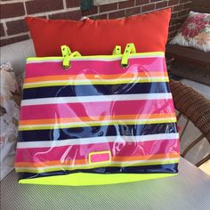 Nine West oversized tote Like new condition. Neon striped tote with hard shell outer. Perfect for beach bag, carry on, for picnic or for mommy out there that is always on the go. Nine West Bags Totes