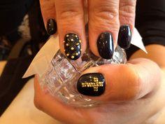 Acrylic nails with black gel polish and caviar as nail art