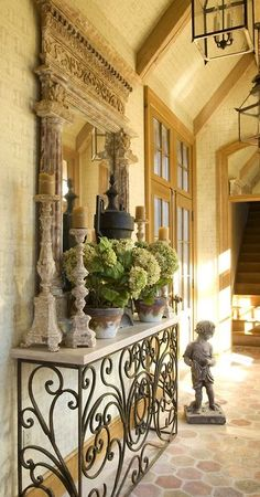 Beautiful space...altar candlesticks, hydrangeas, statue ...