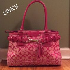 "Coach Hampton Signature Large Carryall Satchel PERFECTION!!!!  This Coach Large Signature Carryall Satchel is in PERFECT CONDITION!!!  Beautiful pick Signature ""C's"" Jacquard Canvas with pink Leather trim. Accent braided belt with nickel (silver tone) clasp, leather tassel, hang tag and proactive feet on bottom. Dual Leather Rolled shoulder straps w/9"" drop. Tan interior, with zip pocket and 2 slip pockets also key hook. This bag is a classic!!!  Measures 15""x10""x5. Large Hampton!!! Coach…"