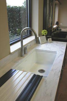 Corian rain cloud countertop, cast iron, under-mounted sink