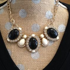 "Black/white/bling statement necklace 16"", plus approximately 3"" extension chain. 3 large oval shaped beads with faux onyx center, surrounded by faux diamonds and a white bead at top and bottom. Large ovals separated by set of 2 stacking white beads with faux diamonds around bottom edge. Set in gold tone metal. Gently pre-loved. Jewelry Necklaces"