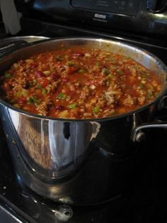 Wendy's Chili Recipe - Ingredients: - 4.5 pounds ground beef - 2 large yellow (sweet) onions, finely chopped - 3 large green bell peppers, finely chopped - 4 celery stalks, finely chopped - 2 heaping tablespoons minced garlic - 2 cans Ranch Style Beans, NOT drained (15 oz cans) - 2 cans dark red kidney beans, drained (15 oz cans) - 2 cans Original Rotel Diced Tomatoes & Green Chili (10 oz cans) - 2 cans stewed tomatoes (15 oz cans) - 4 cans plain tomato sauce (15 oz cans) - 2 packa...